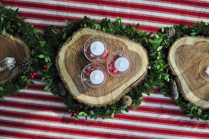 idée deco de table de noel avec matériaux recup, modèle de centre de table en forme de rondelle bois avec gris de verdure