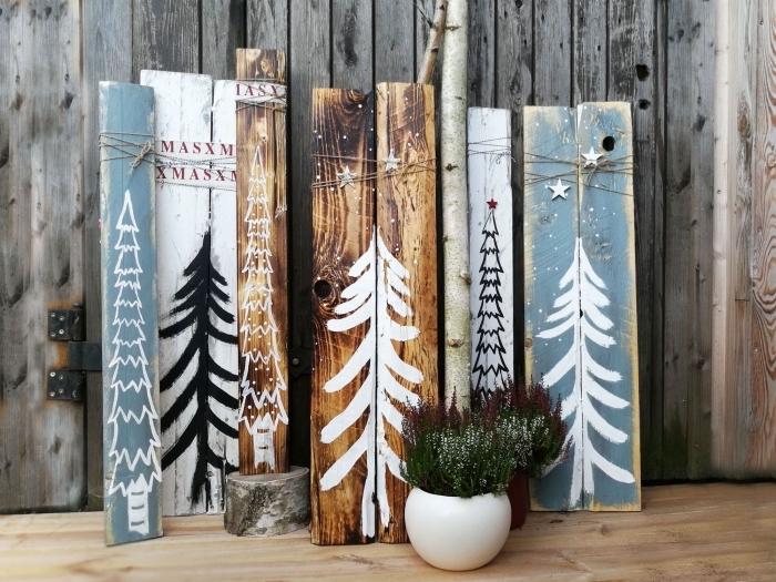 idée décoration de noel à fabriquer gratuit avec morceaux de bois recyclés et repeints à motifs arbres de Noël