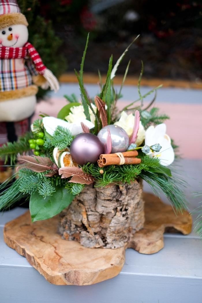 idée activité de noel facile et rapide, modèle de décoration pour table de noël en forme de vase en bois avec branches