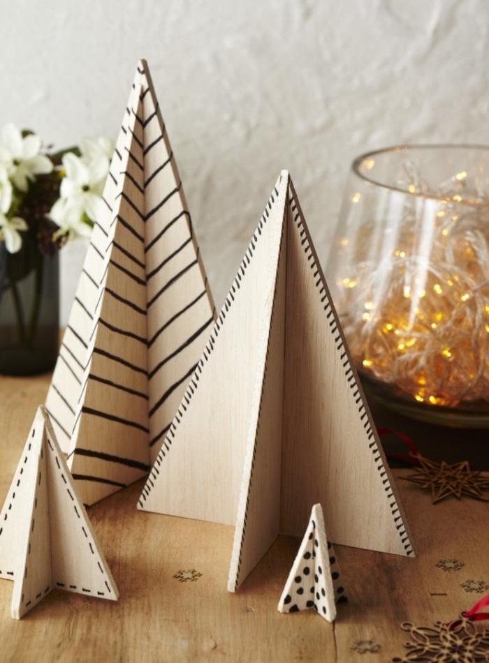 diy mini figurines de noel en forme de sapin en bois, idée de décoration de noel à fabriquer en bois avec dessins motifs géométriques
