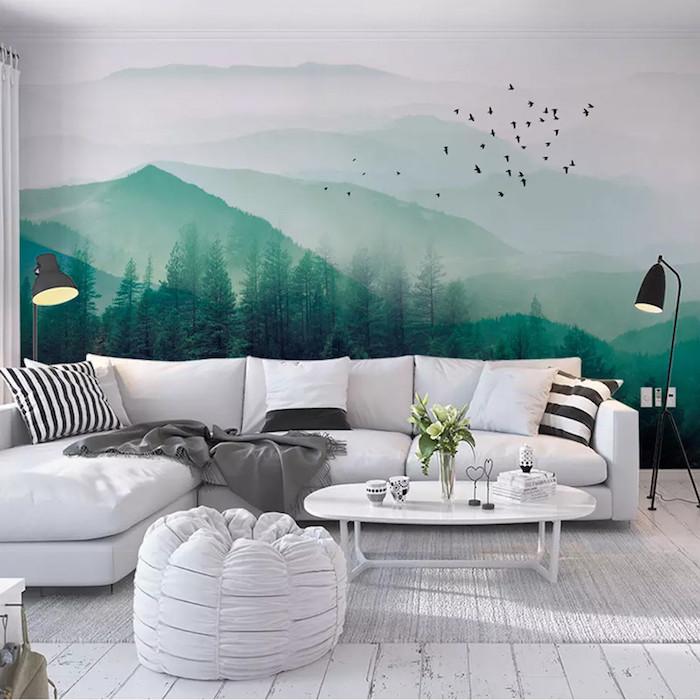 Dessin de montagne sur le mur en vert et blanc, idée salon canapé en angle blanc, peindre une chambre en deux couleurs
