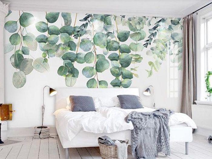 Peinture feuilles vertes sur le mur blanc, idee deco chambre adulte zen, aménagement chambre à coucher