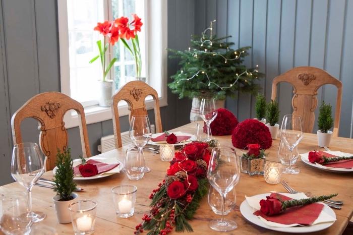idée de centre de table noel à réaliser avec roses rouges et pommes de pin, idée que faire avec des pommes de pin