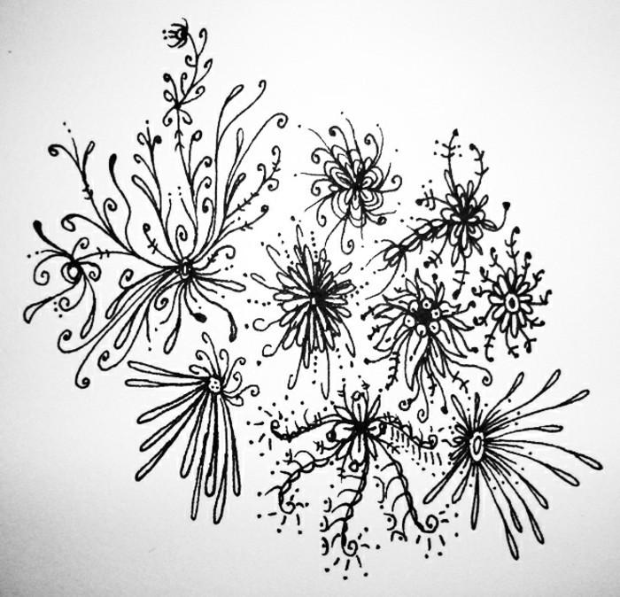 quels motifs faciles à dessiner au crayon sur papier, idée de dessin débutant avec fleurs en lignes volutes