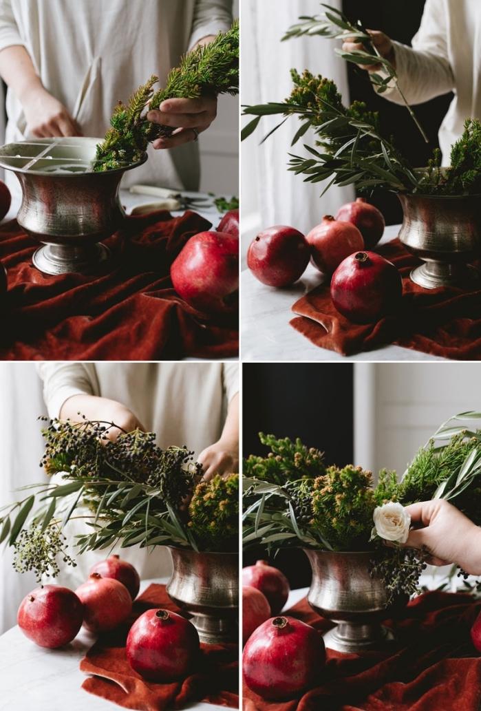 deco table noel à faire avec fleurs et fruits, idée d'arrangement avec fleurs et feuilles d'olivier dans un vase métallique