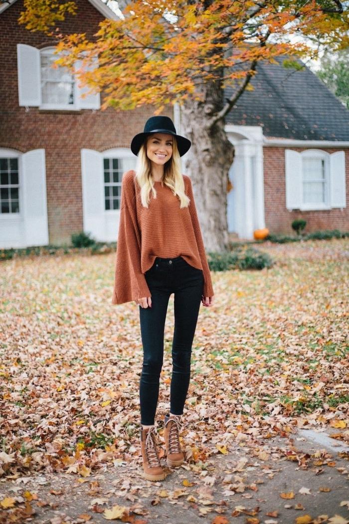 tenue bohème chic en pantalon fit noir combiné avec sweat femme marque de couleur marron et capeline noire
