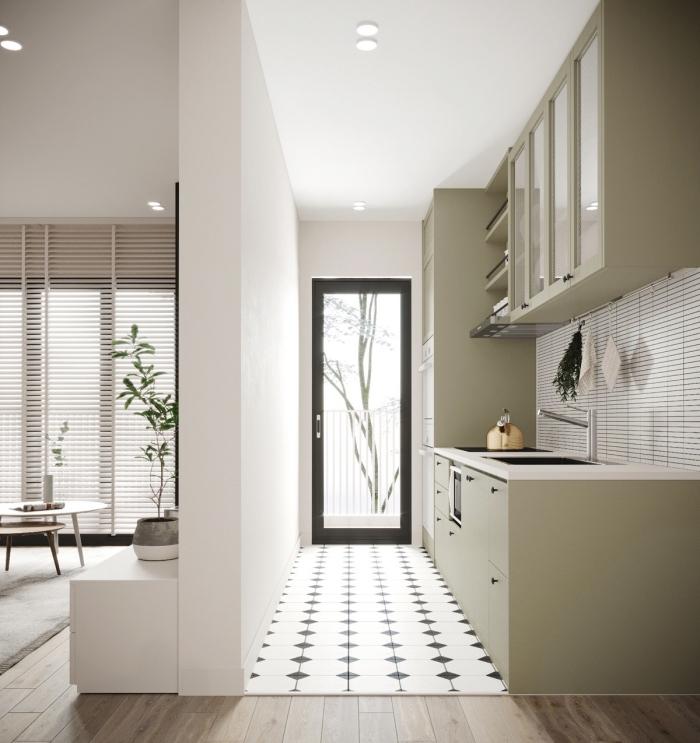 idée de petite cuisine aménagée en longueur avec crédence blanche et meubles de couleur vert pastel à poignées noires