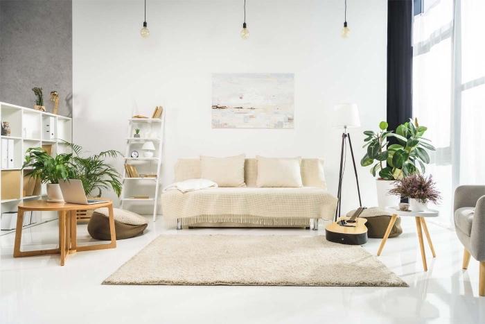 deco chambre adulte de style minimaliste avec accents bohème aux murs blancs et pan de mur en couleur gris