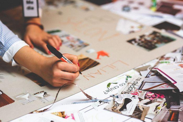 Comment faire un tableau de motivation, créer un tableau visualisation a l'aide des coupes des magasines, femme main avec manucure rouge et stylo