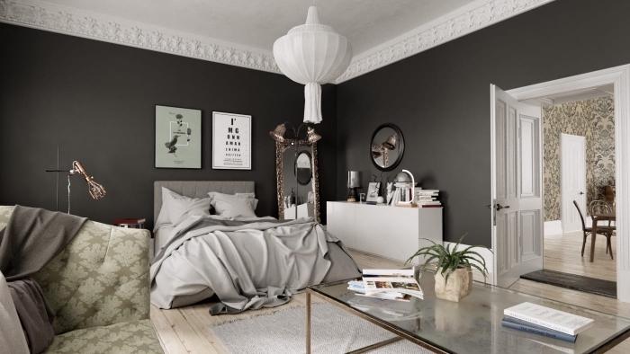 exemple de chambre gris et blanc avec accents en vert, idée comment décorer une pièce aux murs foncés avec meubles blancs et gris