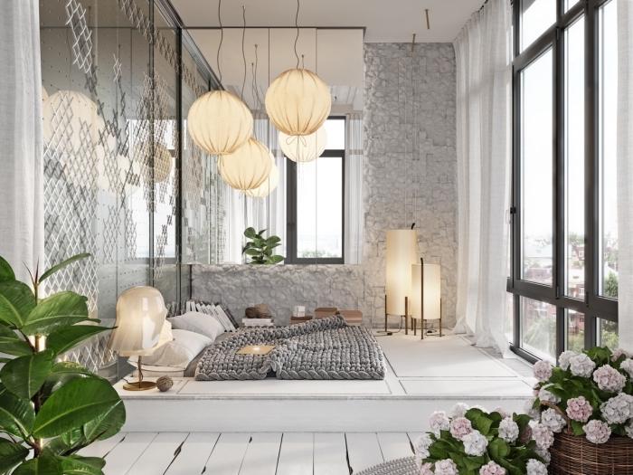 design intérieur chambre a coucher moderne aux murs gris clair avec grands fenêtres et un lit au sol cocooning