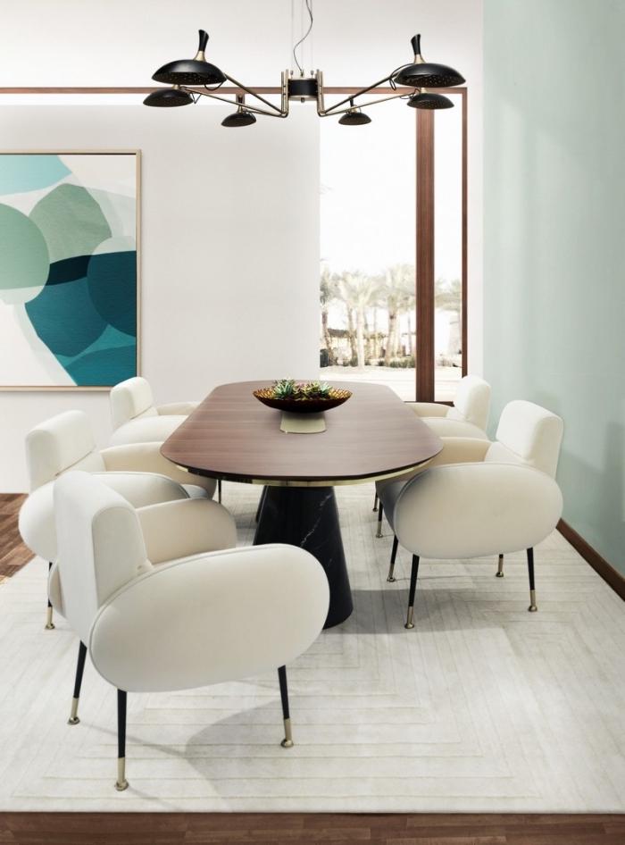 design intéreur moderne dans une salle à manger blanche avec mur vert menthe aménagée avec meubles tendance