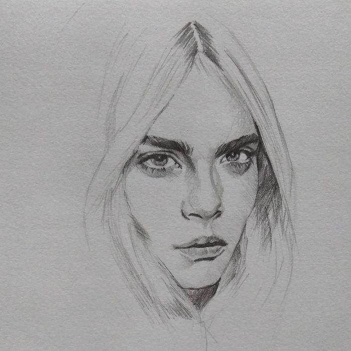 cara delevingne portrait femme simple de visage aux traits réalistes entouré de mèches de cheveux encadrant