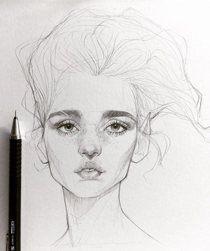 dessin facile a faire etape par etape, idee dessin de fille cheveux en volume, des yeux tristes, petite bouche aux levres pulpeuses, sourcils denses