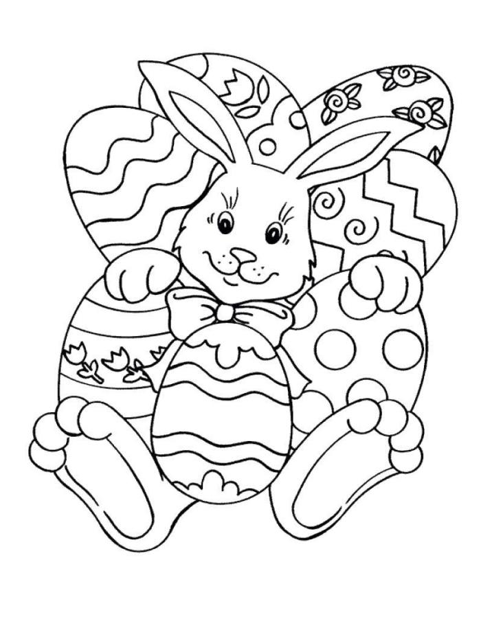 coloriage paques à imprimer pour petits, dessin facile à colorer sur le thème de Pâque avec gros lapin et oeufs