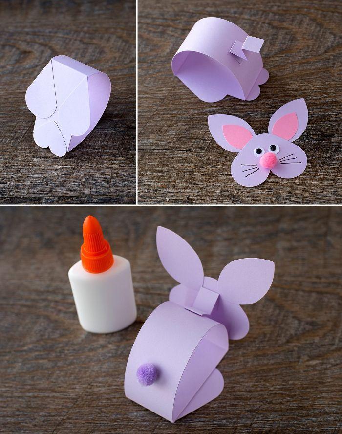 activité manuelle paques maternelle, lapin en papier violet avec des yeux mobiles et pompons rose pour le nez