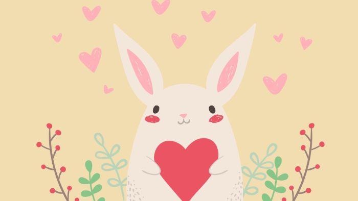 fond d écran pour fille enfant, petit lapin mignon qui tient un coeur entre ses pattes sur fond jaune pale avec des coeurs rose