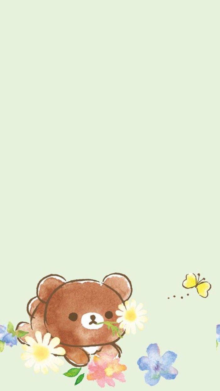 dessin d ourson kawaii de couleur marron avec des fleurs aquarelle autour sur fond bleu