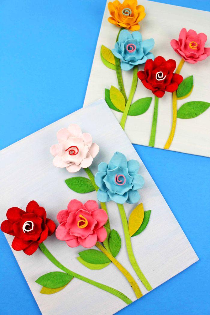 boite d oeud recyclée pour fabriquer une composition décorative de fleurs artificielles sur papier blanc