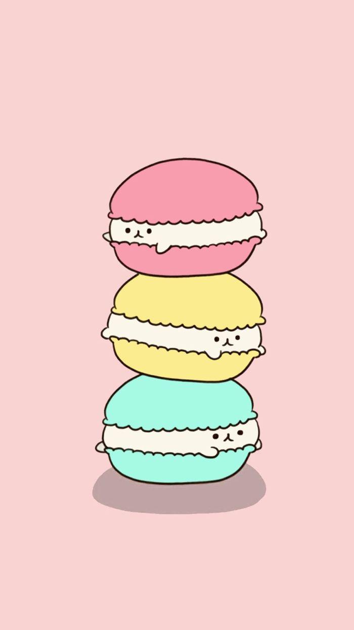 macarons nourriture kawaii, trois macarons superposés de couleur rose, jaune et bleu sur fond rose