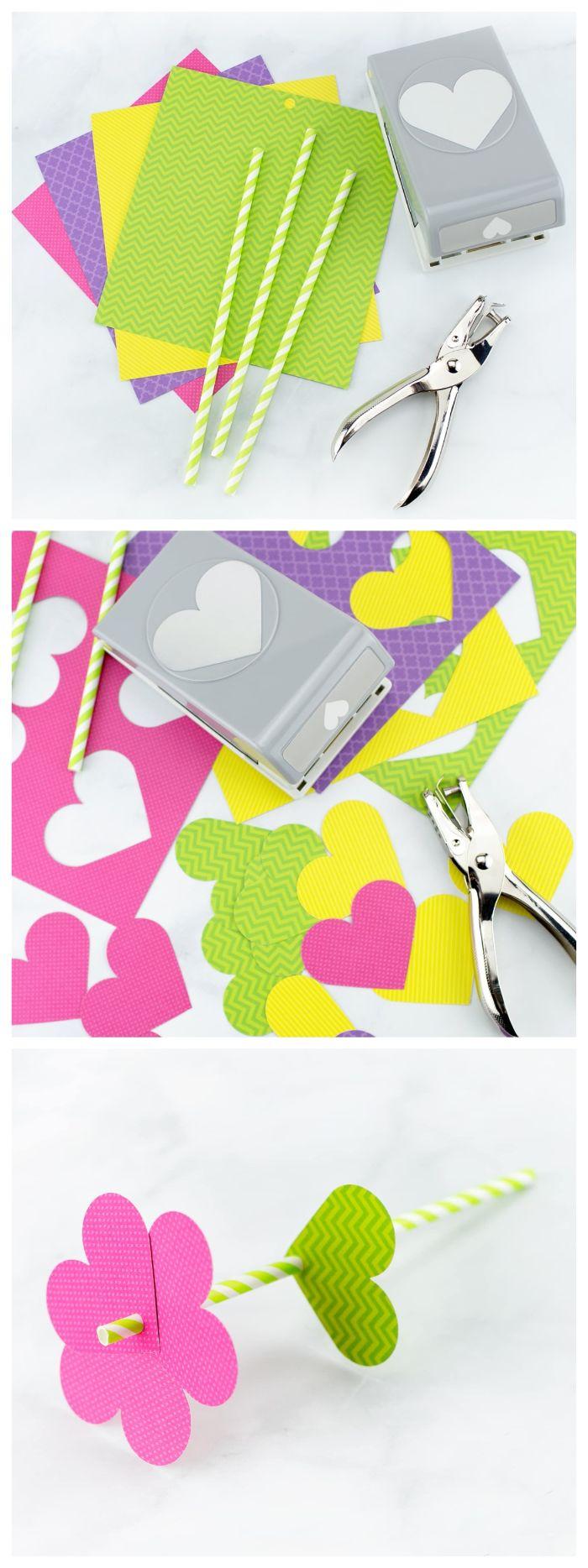 fabriquer une fleur de papier scrapbooking avec des motifs de coeurs en papier sur une paille