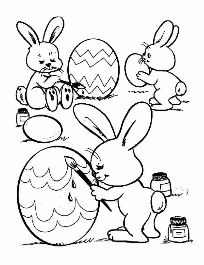coloriage lapin facile pour enfant, idée dessin facile à imprimer sur le thème de Pâques avec lapins artistes