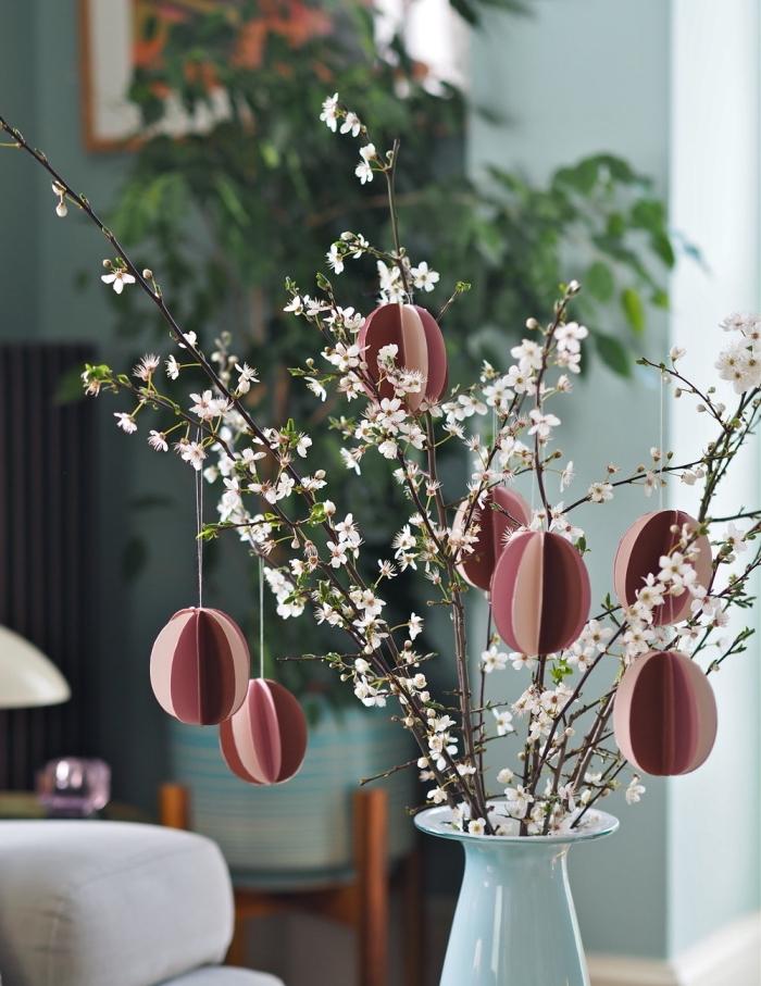 activité manuelle paques facile, faire des oeufs en papier origami facile, diy bouquet de branches fleuries avec oeufs en papier