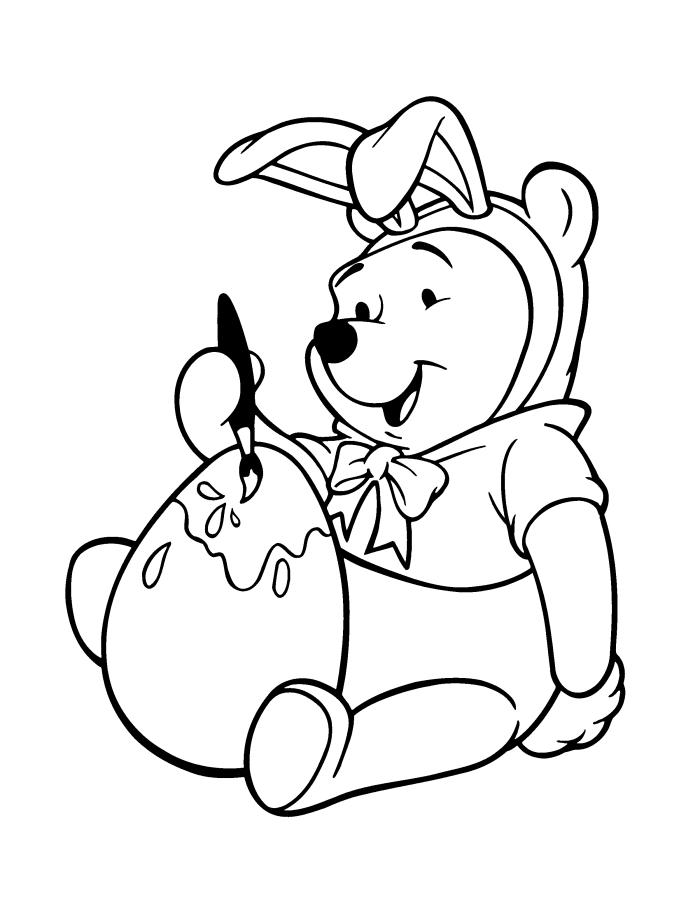 dessin de paques a imprimer, coloriage Disney avec Winnie L'ourson déguisé en costume de lapin de Pâques