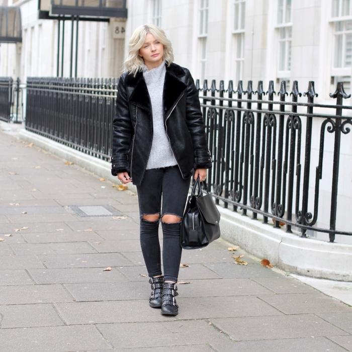 comment porter une veste noire oversize, idée de tenue chic femme en pantalon troué noir et pullover blanc avec accessoires noirs