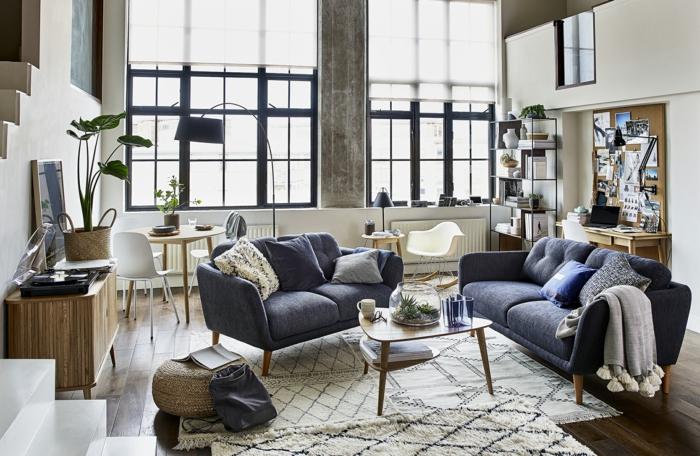Salon bien aménagé pour se sentir bien a la maison, canapé gris, table ronde, déco de petit appartement, aménagement studio moderne boheme