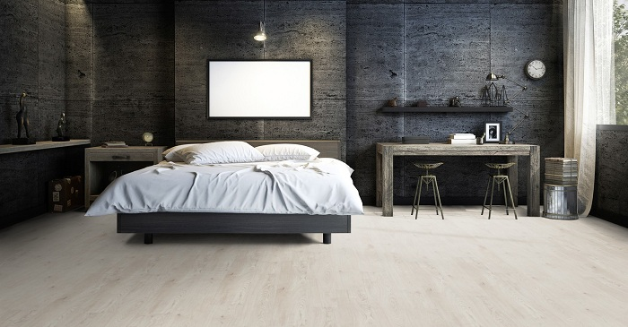 Le sol en vinyle et son adaptabilité s'accoree parfaitement à la chambre à coucher