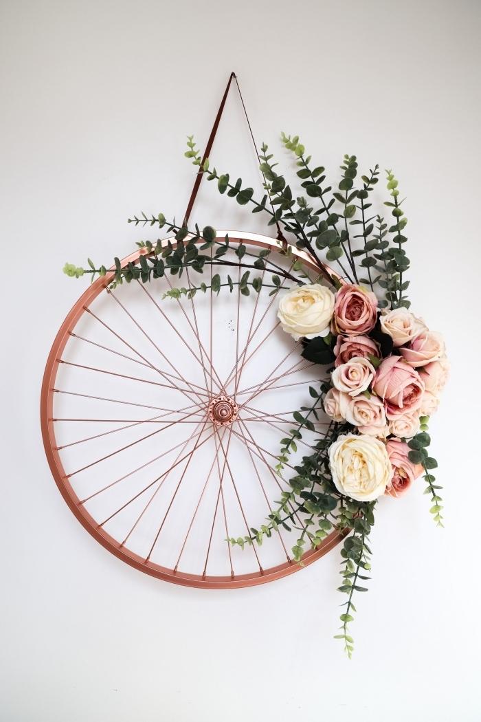idée que faire avec un vieux pneu, loisirs créatifs adultes pour printemps, diy suspension murale avec pneu et roses