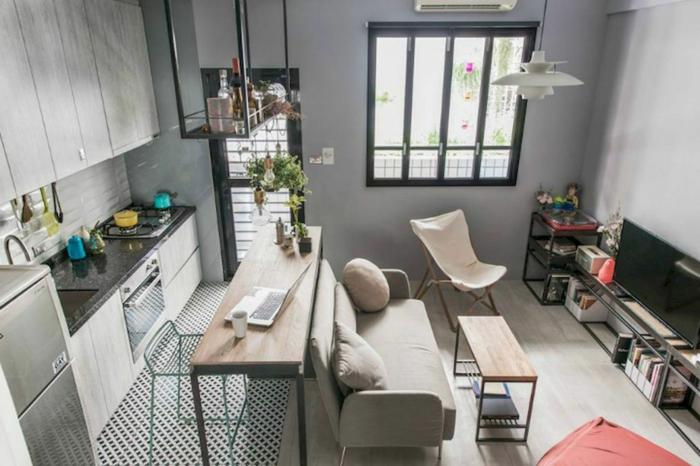 Gris murs déco de petit appartement, aménagement studio moderne boheme table bois