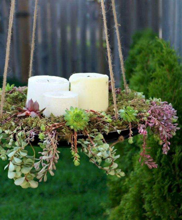 idee deco recup exterieur avec assiette plateau de succulents suspendu avec des bougies a l interieur