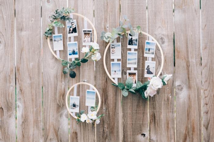 Mariage décoration photographies instantanés dans cadre ronde en bois et fleurs, porte photo mural, coeur en photo, se sentir bien dans sa chambre déco