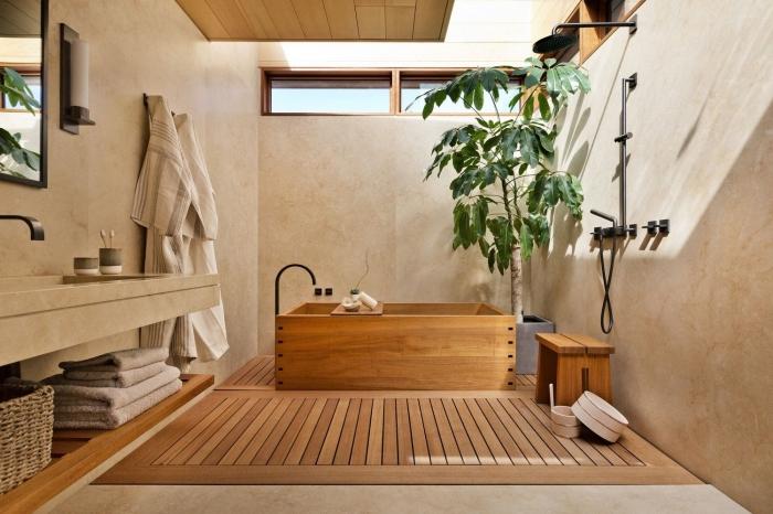 comment décorer une salle de bain japonaise en bois, design salle de bain aux murs aspect pierre et plafond en bois clair