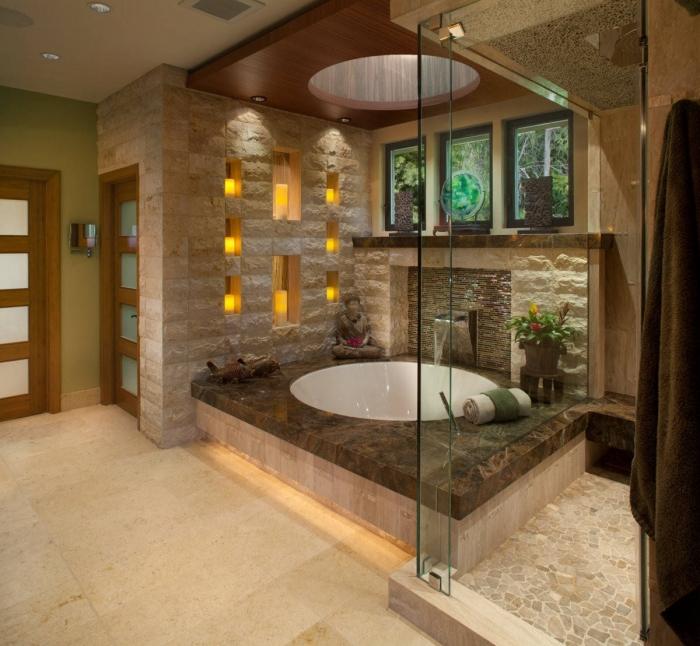 idée comment décorer une salle de bain zen avec statuettes de bouddha et bougies, design petite salle de bain avec baignoire