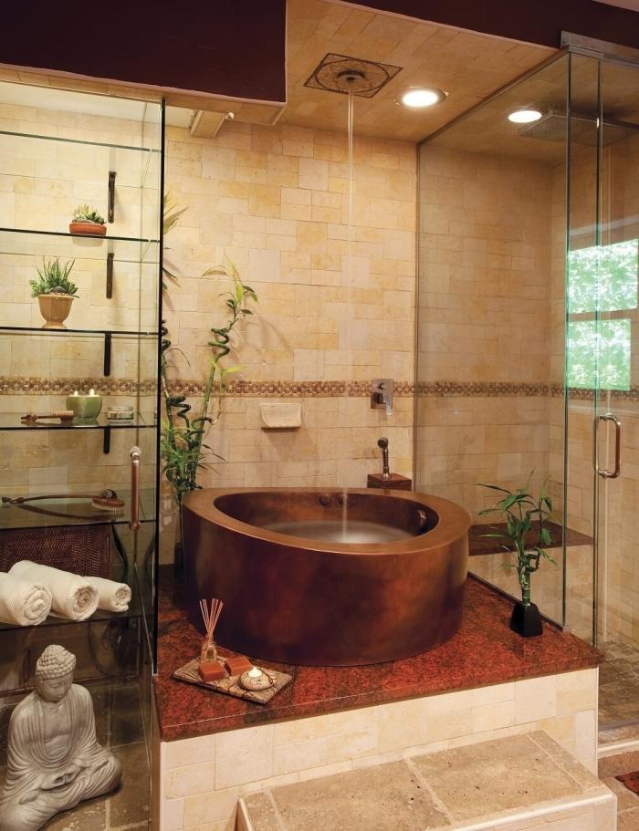idée comment décorer une salle de bain zen avec baignoire et douche, accessoires décoratifs de style asiatique avec statuette et bougie