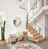 aménagement entrée maison interieur tapis rond beige banquette d angle bois clair miroir rond cactus cache pot fibre végétale