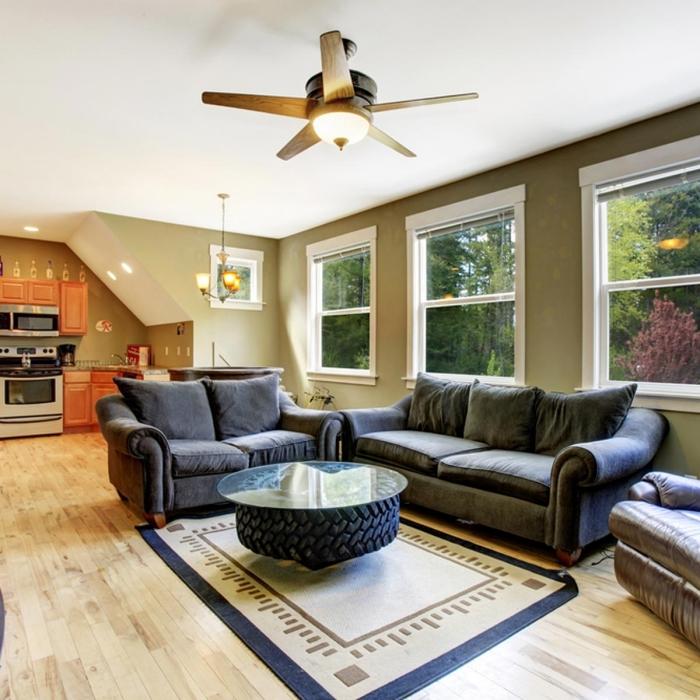exemple comment décorer son salon avec un meuble DIY, modèle de table basse en pneu recyclé, idée de deco pneu facile