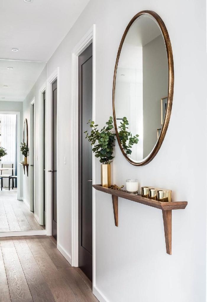 design intérieur tendance style contemporain idée décoration entrée appartement moderne couleur couloir blanc portes noires décoration de couloir d'entrée