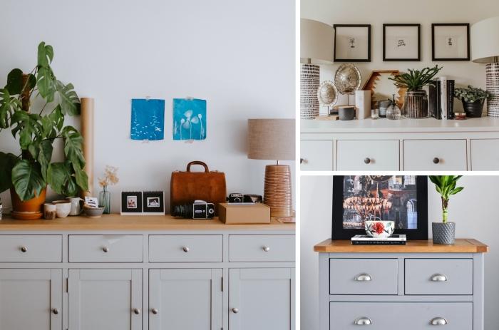 design salon meuble gris clair et bois commode rangement accessoire pot fleur terre cuite mur de cadres photos noirs lampe or