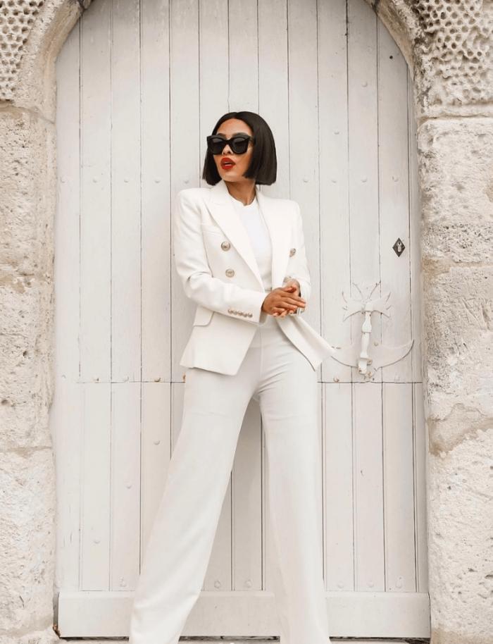 comment porter le blanc, ensemble pantalon femme de couleur blanche en combinaison avec maquillage avec rouge à lèvre rouge