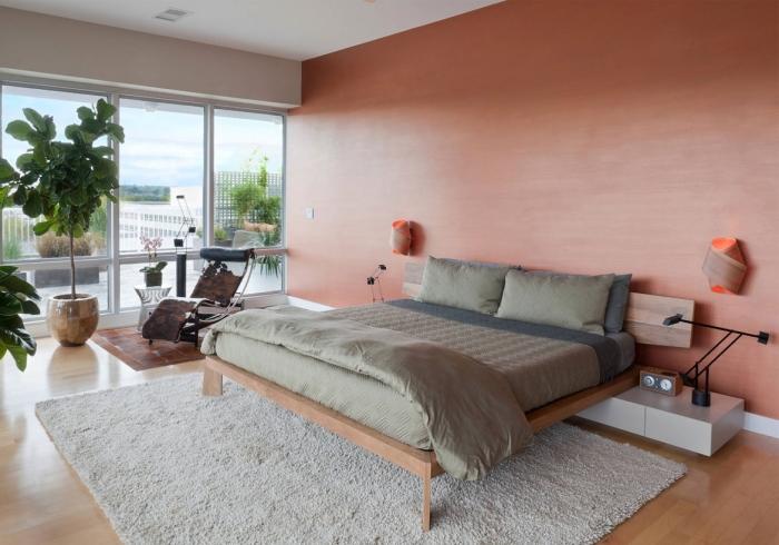 couleur terre cuite chambre moderne tapis moelleux blanc plantes vertes tête de lit bois cadre peinture tendance applique murale design