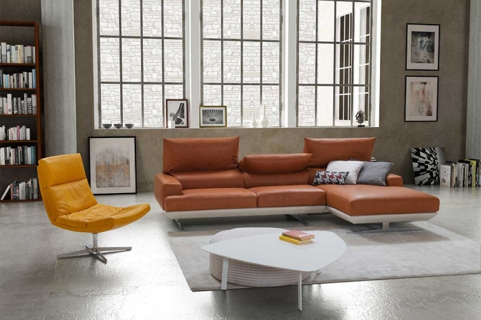 design intérieur décoration salon style industriel table basse blanche style contemporain canapé terracotta cuir d angle bibliothèque bois foncé
