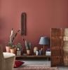 peinture tendance cactus pot de fleur terre cuite tapis motifs géométriques fauteuil velours beige couleur de peinture pour salon moderne