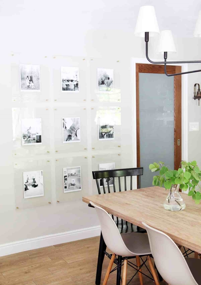 deco photo sur mur chaise noire aménagement salle à manger chaise blanche et bois table à manger bois plante verte