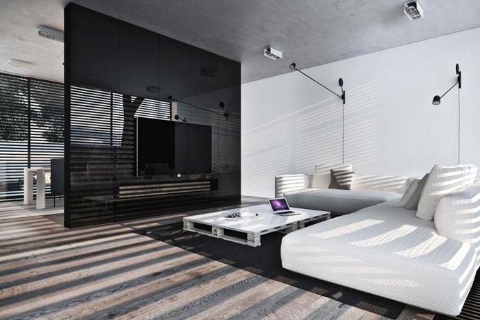 deco salon moderne noir et blanc gris table basse palette bois blanc canapé d angle blanc mur séparation noir plafond béton