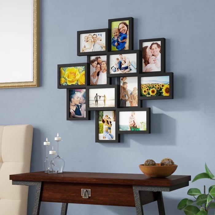 idee deco mur salon cadres noirs meuble bois foncé et pieds métal plante verte d intérieur bol bois bougeoirs verre