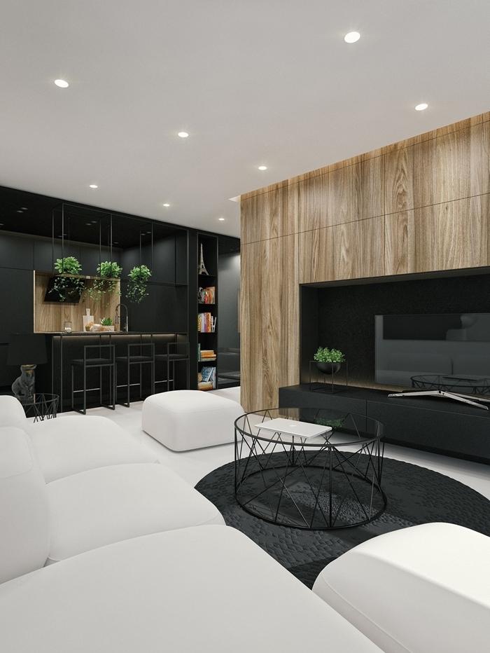 salon blanc et bois revêtement panneaux bois spots led éclairage cuisine noire et bois canapé blanc table verre et métal noirci